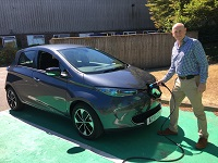 Cllr Lance Stanbury, Forest Heath District Council Cabinet Member for Planning and Growth with an electric vehicle