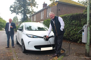 Councillor John Griffiths charging an electric car